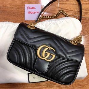 Gucci Marmont mini flap bag in black